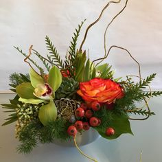 A Texture Bowl with an autumnal theme. High & Magic roses, cymbidium orchids, succulents, rose hips, leucadendron, grevillia, tree ivy, ming fern and curly willow in a brushed aluminum bowl.