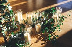 A Night at the Vineyard winter open house. Arrange candles and greens on the floor for a unique decorative touch. #brodiehomestead #weddingvenue #austinwedding #weddingideas