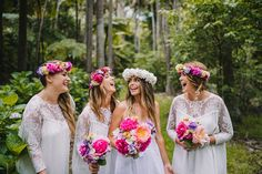 Bridesmaids in white dress and vibrant flowers