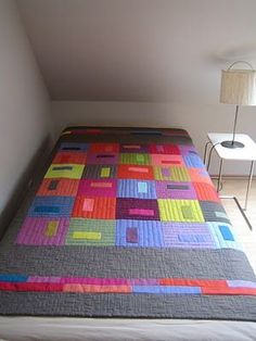 German quilt--pretty solids - the vertical quilting makes this quilt