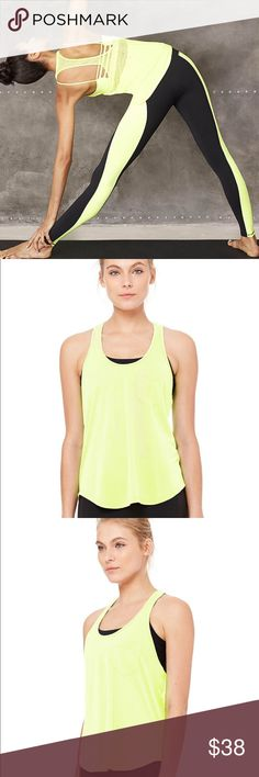 """NWT Alo Yoga Extreme Racerback Tank in Highlighter This flowy Extreme Racer Tank is both functional and free spirited with a draped micro-mesh racerback that takes you from yoga to afternoon juice stops.  Great layering piece with extreme dropped back & armhole to showcase bra underneath Scooped neckline Front pocket detail Flowy silhouette Model Stats: Chest 34A, Waist 24"""", Height 5'10""""; Wears Size S  Fabrication: Poly Viscose + Micro Mesh Mesh detail at racerback for transparency and…"""
