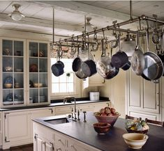 Same kitchen, different view.. love the pots hanging and the glass front cabinet.