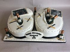 Numeral cake in black and gold with champagne bottles & edible images