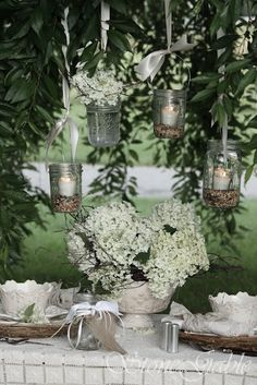 Hanging jar candles tied with ribbons. Easy way to make your table lovely.
