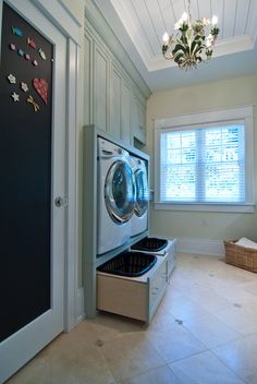 Built-in washer and dryer with hamper storage below... yes please!