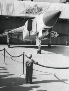 A little boy watches the Canadian-built fighter, the Avro Arrow, as it is wheeled out of its hangar in 1958 or Military Jets, Military Aircraft, Fighter Aircraft, Fighter Jets, Avro Arrow, Canadian History, American History, Air Festival, Vintage Airplanes