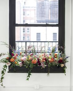 At your next get-together, consider adding a novel feature: an interior window box. While most people know the feature as a box that hangs outside of a window, window boxes function really well indoors– they're unexpected, they add a lushness, and they help frame a view by guiding the eye towards outdoor light. #interiordesign #weddings #floraldesign