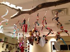 """Hanging Art -  strands of assorted beads, ribbons & other objects, created by children & hung from a tree branch ("""",)"""