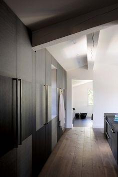 Love the dark cabinets looks so clean, modern and sleek #modern #closet #design