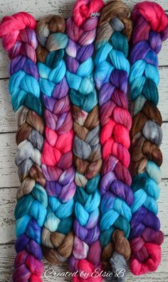 4 ounce dyed Merino and Rainbow Firestar combed toproving