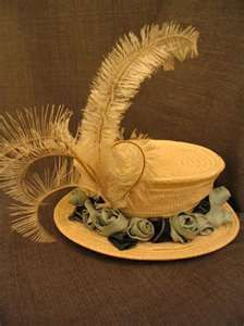 1900 yellow hat with feather and flower accents.