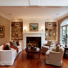 I love the way this room has the fireplace as the focal point, but is arranged for conversation first. It feels homely and comfortable - and to me comfort equals #Tranquility. Traditional Living Room by Grande Interiors