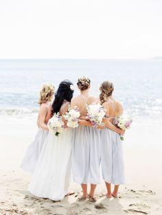Beachy blue bridesmaid dresses: http://www.stylemepretty.com/destination-weddings/2015/12/22/intimate-maui-wedding/   Photography: Christie Graham - http://www.christiegraham.ca/