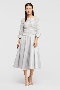With a lace bodice featuring contrasting cuffs, ruched waist, and A-line skirt, this floor-length dress combines textures for a rich effect.  By Jessica Howard  Taffeta  Back zipper; fully lined  Dry clean  Imported Protect your dress before you wear it with our Garment Bag.