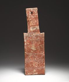 Terracotta plank-shaped figurine  Period:     Early Cypriot III–Middle Cypriot I Date:     ca. 2000–1800 B.C. Culture:  Cypriot.