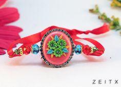 polymer clay embroidey rakhi by www.facebook.com/zeitx