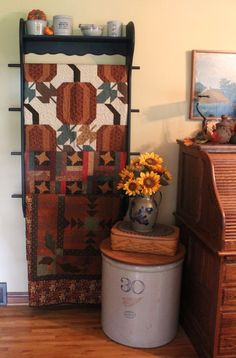 decorated for fall - lots of quilts