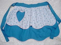 Blue Reversible Tiered Apron w Heart Pocket    http://www.etsy.com/listing/97680412/vintage-kitchen-apron-tiered-petal-shape