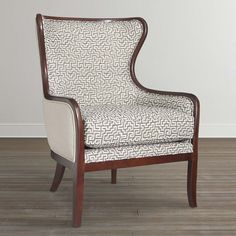 Lily Accent Chair by Bassett Furniture features a curved barrel back with wood trim outlining the entire chair.