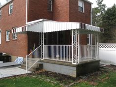 Pan & Cover Aluminum Awnings with White Aluminum Railing
