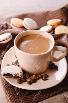 Gentle colorful macaroons and  coffee in mug on wooden table background Stock Photo - 38034526