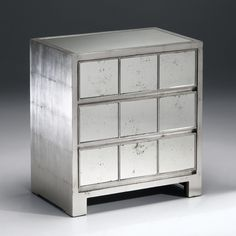"""Rectangular chest with antiqued silverleaf finish, antiqued mirrored top and three drawers with antiqued mirrored panels; 26"""" w. x 16"""" d. x 28¼"""" h."""