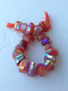 ❥ Carnelian gemstone beads with a beautiful AB (Aurora Borealis) lustre gives off flashes of blue, green, pink and gold when turned in the light. $13.00