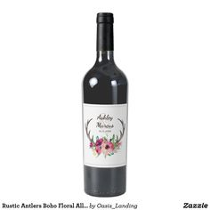 Rustic Antlers Boho Floral Allure Wine Label - With enchanting rustic boho style, this wedding wine label design features deer antlers beautifully embellished with watercolor florals in rich purple, magenta and pink hues. This label makes a lovely choice for wedding favors, special celebrations, bridal party gifts and more. Sold at Oasis_Landing on Zazzle.