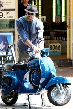 huge jackman & his blue Vespa.  Such handsome. Wow