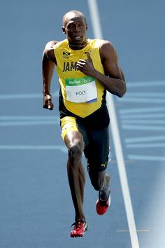 Usain Bolt of Jamaica competes in the Men's 100m Round 1 on Day 8 of the Rio…