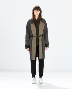 Image 1 of FAUX LEATHER BELTED COAT WITH PIPING from Zara