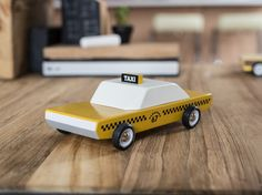 """It's safe to say that the classic yellow and checkered New York City cab has entered the world of iconography. With Candylab Toys' """"Candycab,"""" there's a solid beechwoo… Wooden Toy Cars, Wood Toys, Toddler Toys, Kids Toys, Baby Toys, Push Toys, Baby Diaper Bags, Car Makes, New Toys"""