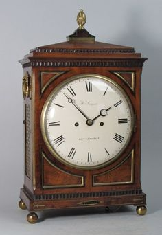 'He pressed his fingers to the vein to staunch the bleeding, looked desperately at the carriage clock on the mantel piece to determine how long he had drunk from her.' This pic - A Regency bracket clock