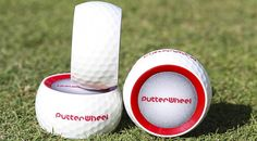 """PutterWheel Golf Trainer   The PutterWheel is a unique wheel-shaped putting training aid that helps you improve your line of sight, setup and stroke — mis-hits wobble and curve immediately off the clubface. The patent-pending system also comes with an alignment tool that draws 2 lines on your game ball so that you can take your visualization of """"rolling the wheel"""" to the course. (Price: $39.99)"""