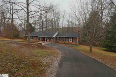 Full brick ranch on 2.1 acres on #GreenvilleSC for just $189,900! No HOA, updated, and backs to more wooded acreage! #homeforsale #realestate