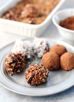 A basic combination of cream cheese, powdered sugar, melted chocolate, and vanilla are made into balls, then rolled in chopped toasted pecans,coconut and cocoa powder
