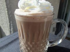 (Instant) Cafe Mocha:  1/4 cup milk,  1/4 cup half-and-half,   1 tablespoon hot cocoa mix,  1 tablespoon chocolate syrup,  1/2 cup coffee, strongly brewed.  Directions:  Combine milk, half and half, hot cocoa powder, and choclate sauce in a mug.   Heat on medium power in microwave for 2 minutes. Then stir in hot coffee. Top with whipped cream and enjoy!