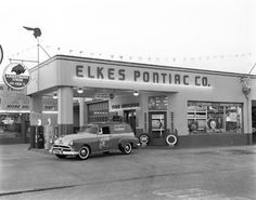 A black and white photo of the Elkes Pontiac Co., a gas station located at 1101 Florida Ave. in Tampa on October 2, 1953.