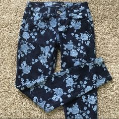 AE floral denim Great condition. Good quality jeans. Stretch. Dark blue with light blue flowers. Skinny leg American Eagle Outfitters Jeans Skinny