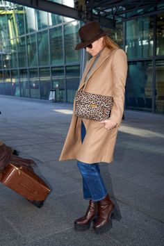 Designer Stella McCartney travels in cropped jeans and a fresh camel coat