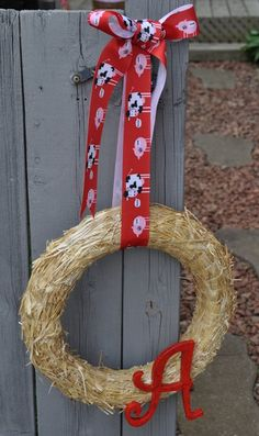 Greet guest with a themed-wreath (see this example from a farm-themed party)