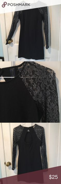 Petticoat Alley LBD This hot LBD is in gently worn condition, but that doesn't make the patterned sleeves or the keyhole back any less cute. Petticoat Alley Dresses Mini