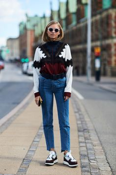 Chunky printes sweater, uneven hem jeans, and sneakers. WOMEN'S ATHLETIC & FASHION SNEAKERS http://amzn.to/2kR9jl3