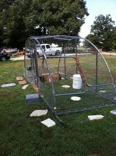 My Chicken Tractor for meaties and a brooding pen. Took a Trampoline frame and cut it in half, welded the bottom of the legs together and put in a metal lower frame and door. lite enough for me to move by myself.