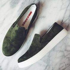 Prada Olive Green Suede Slip Ons On trend suede slip ons from Prada in olive green. True to size but best for a narrow or normal width foot. EU37. Display shoe so there are some very light/minimal marks, like new condition. NO TRADES/PAYPAL. Prada Shoes Sneakers