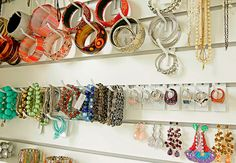 Slatwall and Hooks for Jewelry organization - in this case hidden behind mirrored door