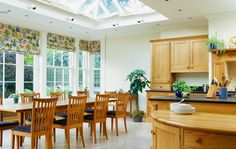View of a dining area in a kitchen room featuring sliding sash windows