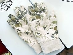 This Easy 10 Minute Garden Gloves sewing tutorial will show you how to turn an old sweatshirt into beautiful gloves for gardening. Recycle the winter blues with this cute pair of gloves for spring! Sewing Hacks, Sewing Tutorials, Sewing Patterns, Sewing Ideas, Sewing Tips, Fabric Crafts, Sewing Crafts, Sewing Projects, Crafty Projects