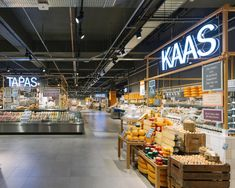 The fresh market is the heart of the store, with each island a manned foodie station