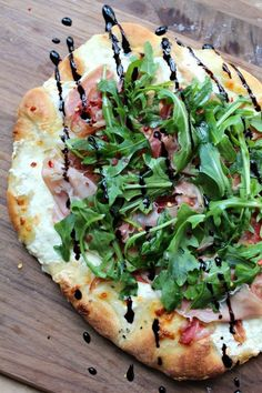 Trader Joe's. Weeknight Easy, homemade, delicious pizza crust topped with prosciutto, arugula and burrata, finished with a balsamic glaze. Pizza Gourmet, Gourmet Foods, Burrata Pizza, Prosciutto Pizza, Ricotta Pizza, Goat Cheese Pizza, Burrata Cheese, Comida Pizza, Good Food